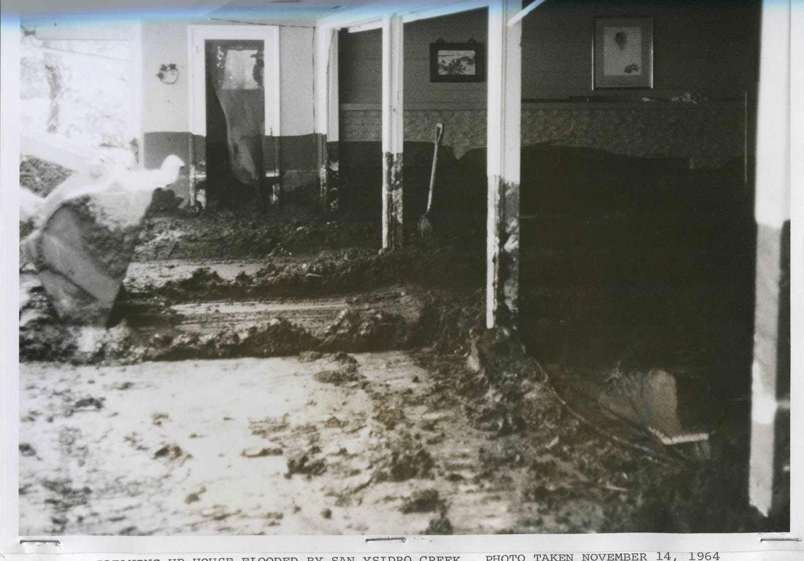 Inside a home near San Ysidro Creek, November 14, 1964. Note distinct mud line on far wall.
